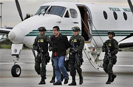 2040655990-police-escort-joaquin-perez-becerra-alias-alberto-martinez-suspected-member.jpg